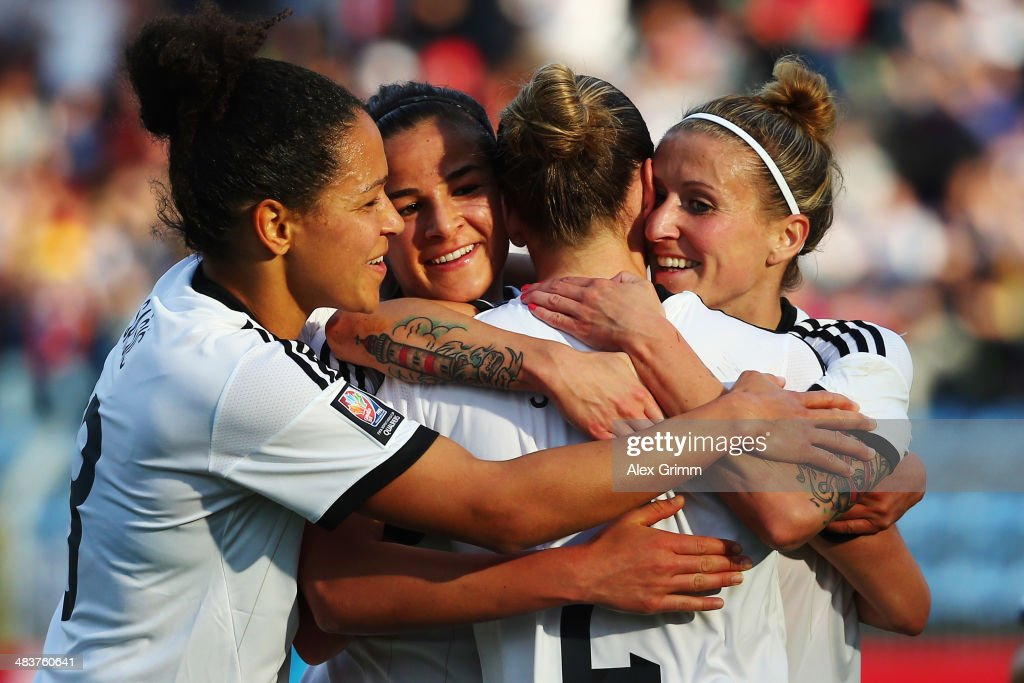 Anja Mittag of Germany scores his team's second goal with team mates Bianca Schmidt, Lena Lotzen and Celia Sasic (R-L) during the FIFA Women's World Cup 2015 qualifying match between Germany and Slovenia at Carl-Benz-Stadion on April 10, 2014 in Mannheim, Germany.