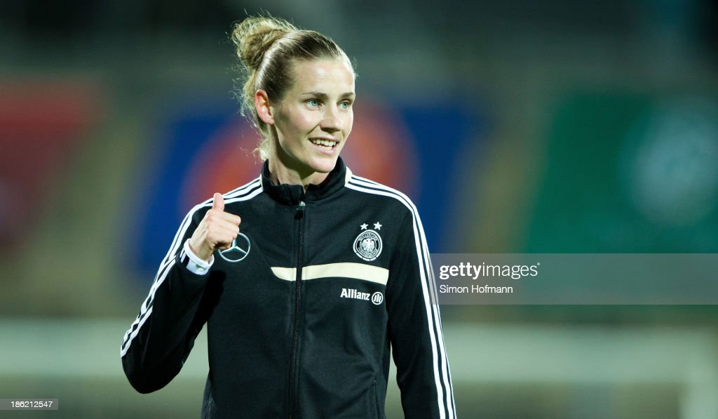Anja Mittag of Germany smiles during a Germany training session at Volksbank Stadion on October 29, 2013 in Frankfurt am Main, Germany.