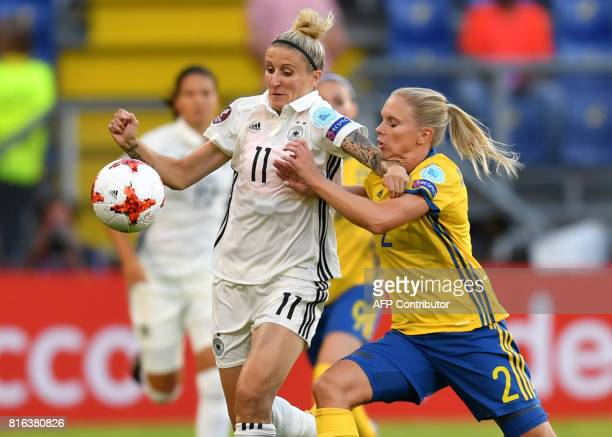 Anja Mittag of Germany vies with Jonna Andersson of Sweden during the UEFA Womens Euro 2017 football tournament between Germany and Sweden at Rat...