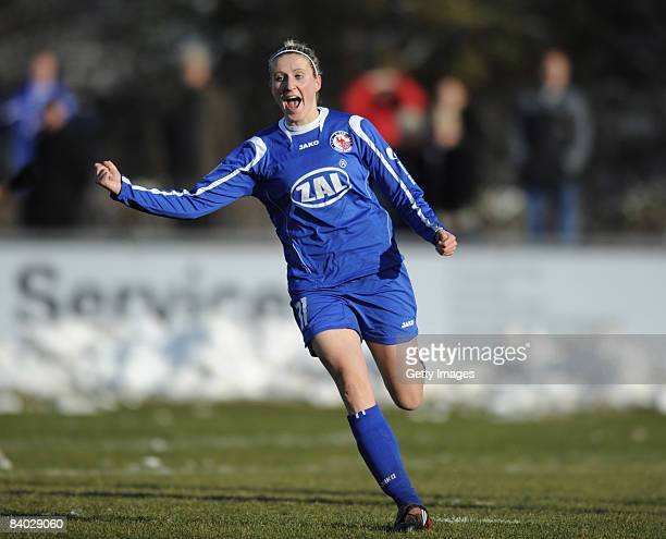 Anja Mittag of Potsdam celebrates the first goal during the Women Bundesliga match between Bayern Muenchen and FFC Turbine Potsdam at the stadium...