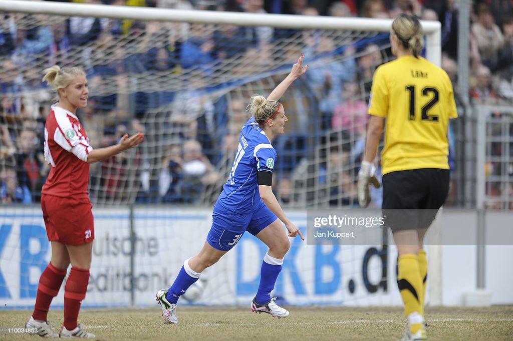 Anja Mittag (C) of Potsdam celebrates the second goal during the Women Bundesliga match between Turbine Potsdam and Essen-Schoenebeck at the Karl-Liebknecht stadium on March 13, 2011 in Potsdam, Germany.