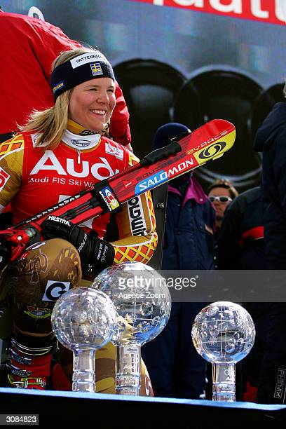 Anja Paerson of Sweden celebrates after claiming the FIS Ski World Cup Overall Globe, Slalom Globe and Giant Slalom Globe March 14, 2004 in...
