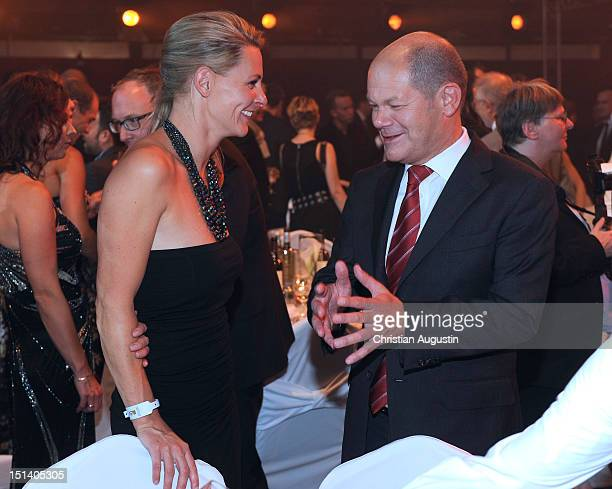 Anja Reschke and Mayor Olaf Scholz attend After Show Party of Deutscher Radiopreis 2012 at Schuppen 52 on September 6 2012 in Hamburg Germany