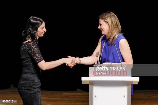 Anja Reschke with the sister of the germanturkish award winnerduring the Emotion Award at Curio Haus on June 28 2018 in Hamburg Germany