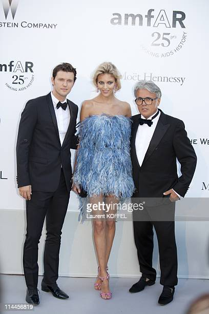 Anja Rubik and Designer Giussepi Zanotti and guest attend amfAR's Cinema Against AIDS Gala during the 64th Annual Cannes Film Festival at Hotel Du...