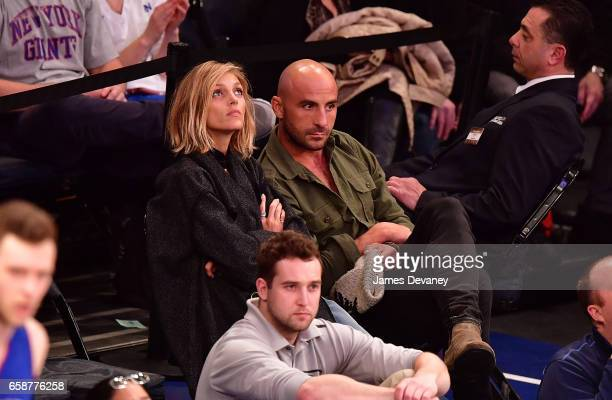 Anja Rubik and guest attend Detroit Pistons Vs New York Knicks game at Madison Square Garden on March 27 2017 in New York City