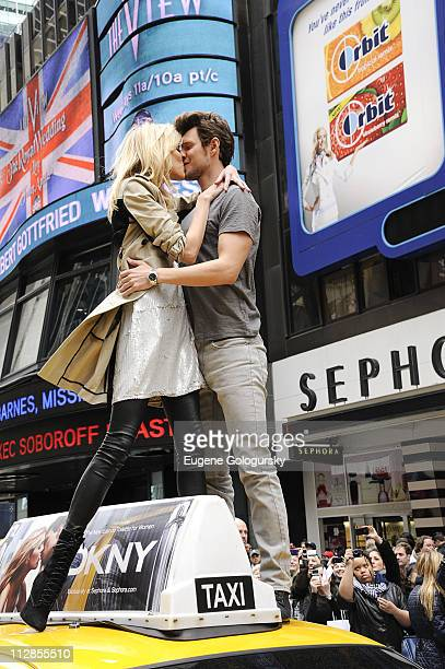 Anja Rubik and Sasha Knezevic attend the DKNY fragrance launch at Times Square on April 22 2011 in New York City