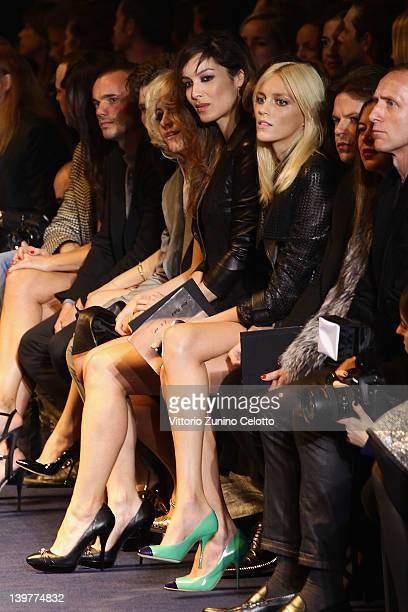 Anja Rubik and Wesley Sneijder attend the Versace Autumn/Winter 2012/2013 fashion show as part of Milan Womenswear Fashion Week on February 24 2012...