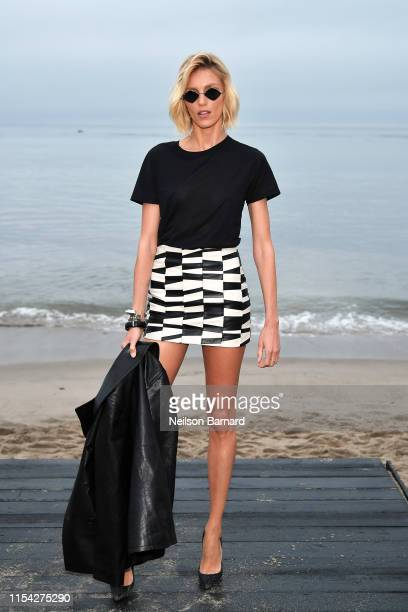 Anja Rubik attends the Saint Laurent Mens Spring Summer 20 Show on June 06 2019 in Paradise Cove Malibu California