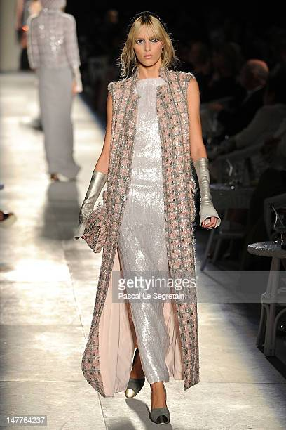 Anja Rubik walks the runway during the Chanel HauteCouture show as part of Paris Fashion Week Fall / Winter 2012/13 at the Grand Palais on July 3...