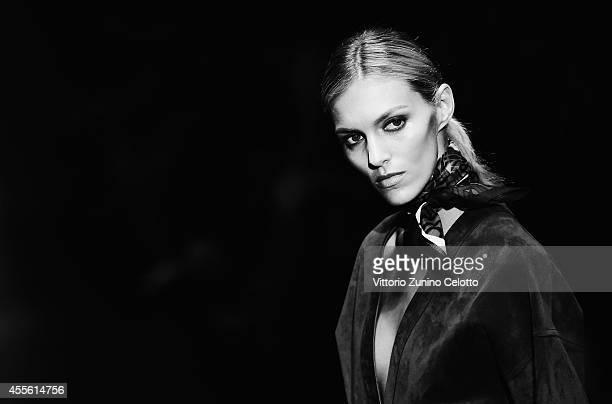 Anja Rubik walks the runway during the Gucci show as part of Milan Fashion Week Womenswear Spring/Summer 2015 on September 17 2014 in Milan Italy