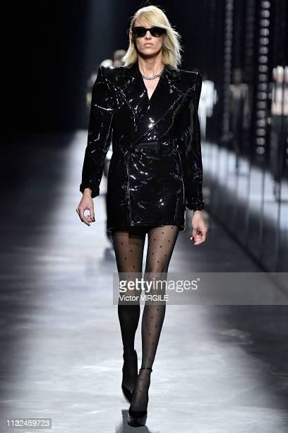 Anja Rubik walks the runway during the Saint Laurent Ready to Wear Fall/Winter 20192020 fashion show as part of the Paris Fashion Week Womenswear...