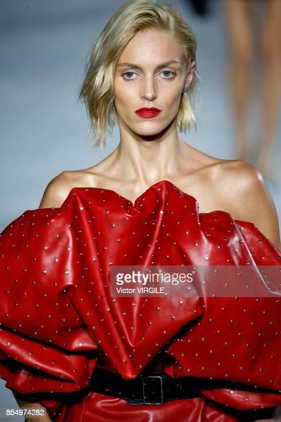 Anja Rubik walks the runway during the Saint Laurent Ready to Wear Spring/Summer 2018 fashion show as part of the Paris Fashion Week Womenswear...