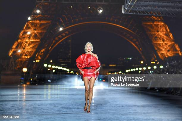 Anja Rubik walks the runway during the Saint Laurent show as part of the Paris Fashion Week Womenswear Spring/Summer 2018 on September 26 2017 in...