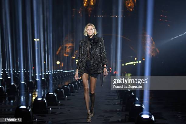 Anja Rubik walks the runway during the Saint Laurent Womenswear Spring/Summer 2020 show as part of Paris Fashion Week on September 24 2019 in Paris...