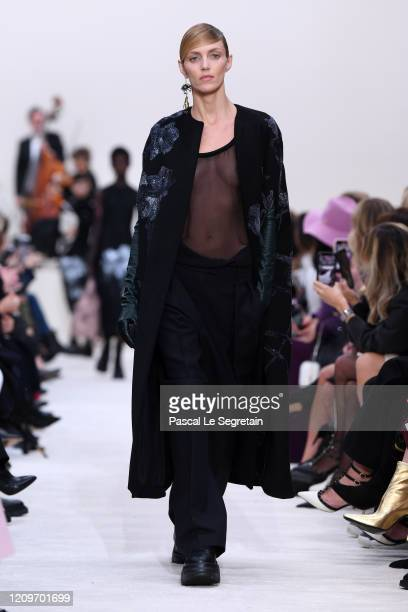 Anja Rubik walks the runway during the Valentino as part of the Paris Fashion Week Womenswear Fall/Winter 2020/2021 on March 01 2020 in Paris France