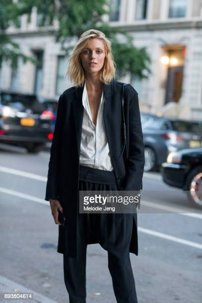 Anja Rubik wears a black jacket and pants with a white top outside the Stella McCartney Spring 18 presentation on June 8 2017 in New York City