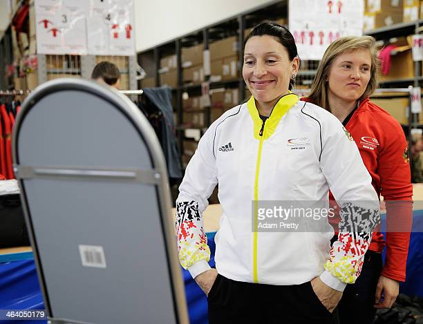 Anja Schneider Heinze and Stephanie Schneider of Germany try on their their Olympic uniform and kit during the Media Day And Kit Handover on January...