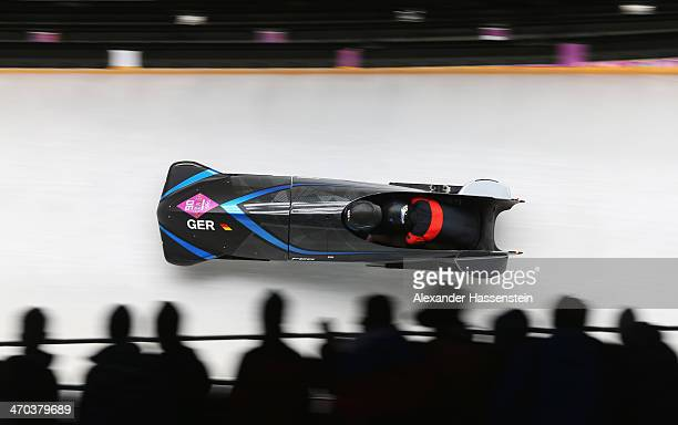 Anja Schneiderheinze and Stephanie Schneider of Germany team 3 make a run during the Women's Bobsleigh on Day 12 of the Sochi 2014 Winter Olympics at...