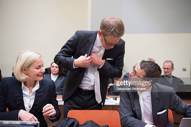 Anja Sturm Wolfgang Heer and Wolfgang Stahl the lawyers of Beate Zschaepe main defendant in the NSU neoNazi murder case talk to each other in court...