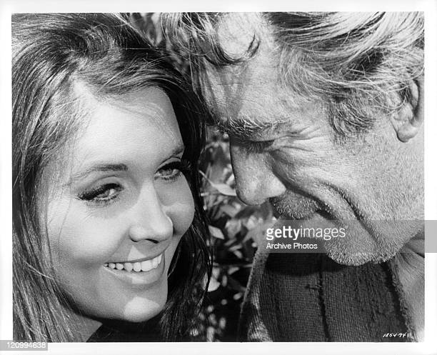 Anjanette Comer and Anthony Quinn share a smile close together in a scene from the film 'Guns For San Sebastian' 1968