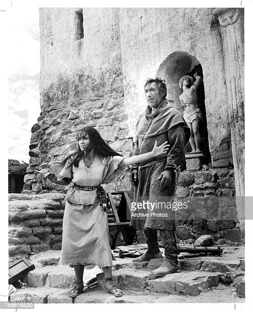 Anjanette Comer pleads for the life of Anthony Quinn who portrays a rebel preist in a scene from the film 'Guns for San Sebastian' 1968