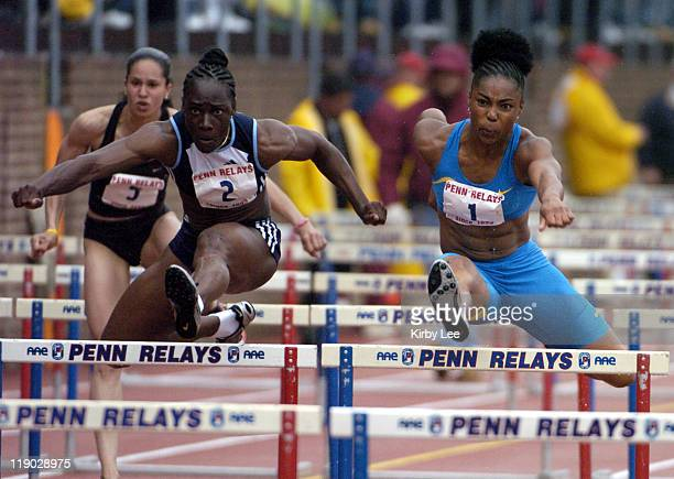 Anjanette Kirkland outduels Michelle Freeman to win the women's Olympic Development 100meter hurdles 1295 to 1308 in the111th Penn Relays at the...