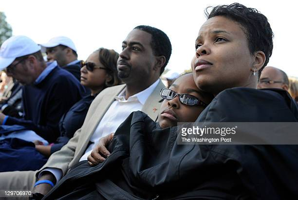Anjanette Taylor right holds her daughter Evan Amina Taylor center right as her husband Montell Taylor center sits next to them during the Martin...