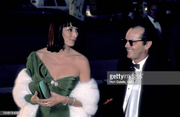 Anjelica Huston and Jack Nicholson during 58th Annual Academy Awards at Dorothy Chandler Pavillion in Los Angeles CA United States