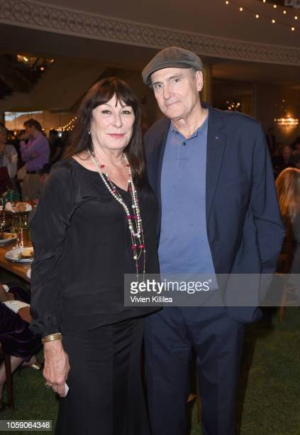 Anjelica Huston and James Taylor attend Joni 75 A Birthday Celebration Live At The Dorothy Chandler Pavilion on November 7 2018 in Los Angeles...