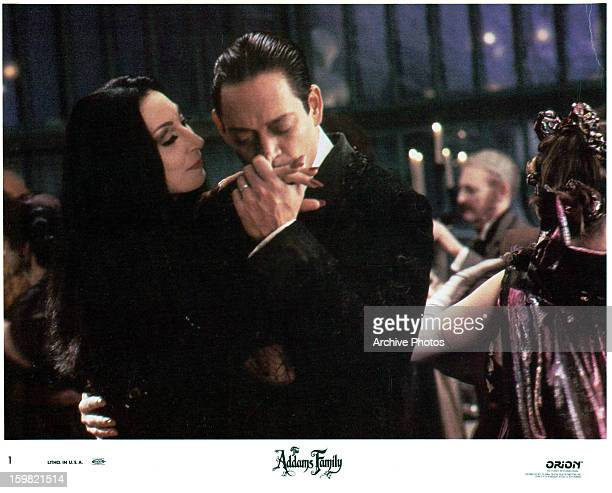 Anjelica Huston is kissed by Raul Julia in a scene from the film 'The Addams Family' 1991