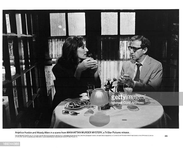 Anjelica Huston sits with Woody Allen in a scene from the film 'Manhattan Murder Mystery' 1993
