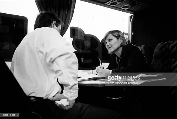 Anji Hunter and Tony Blair discuss tactics on the leaders campaign bus during the general election campaign of 1997 Hunter met Tony Blair at...