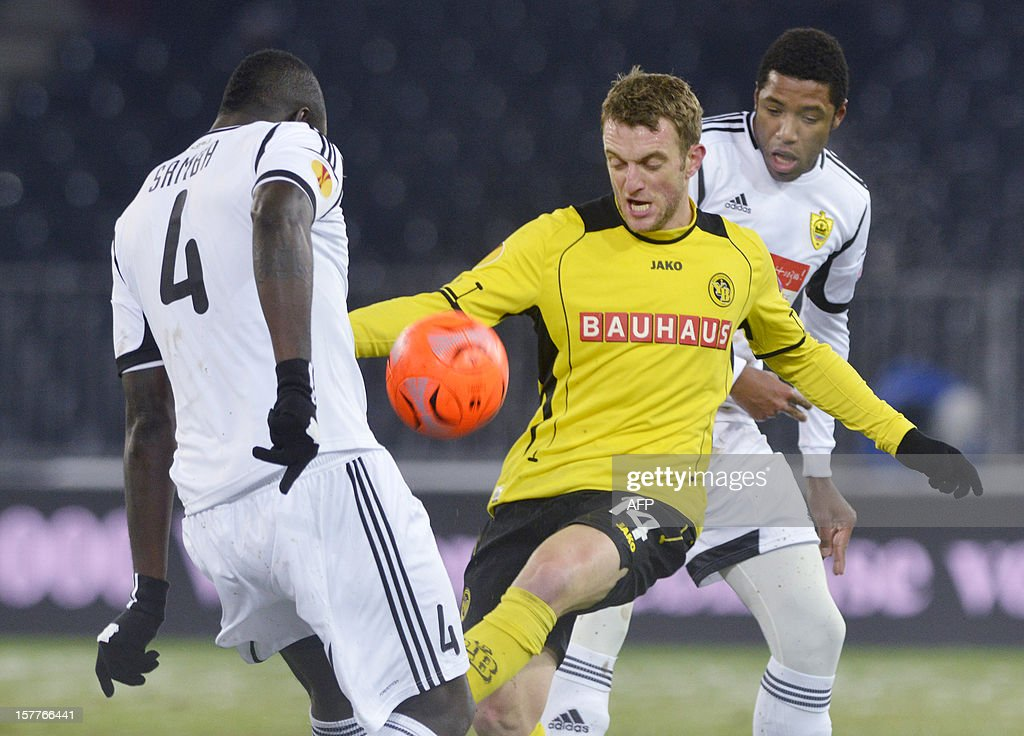 Anji's defender Christopher Samba (L) vies with Young Boys' forward Christian Schneuwly (R)during the Europa League, Group A, football match between BSC Young Boys and FC Anji Makhachkala on Decenber 6, 2012 in Bern.