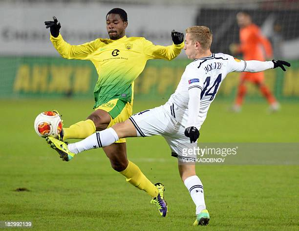 Anji's midfielder Abdul Razak vies with Tottenham's midfielder Lewis Holtby during the UEFA Europa League Group K football match Anji Makhachkala vs...