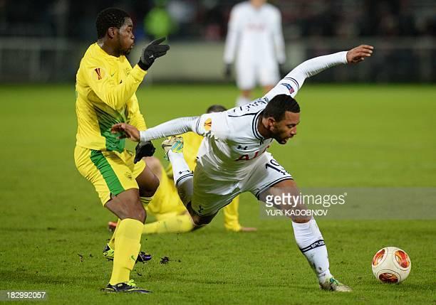Anji's midfielder Abdul Razak vies with Tottenham's midfielder Moussa Dembélé during the UEFA Europa League Group K football match Anji Makhachkala...