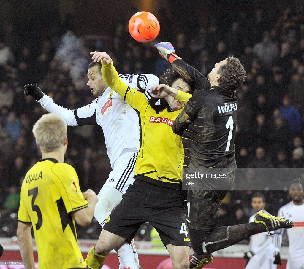 Anji's player Jucilei (L) vies for the ball with Young Boys's Alain Nef (C) and goalkeeper Marco Wolfli (R) during the Europa League group A football match between BSC Young Boys and FC Anji Makhachkala on Decenber 6, 2012, in Bern. Despite winning the match the YoungBoys did not qualify for the next round of the Europa League championship.