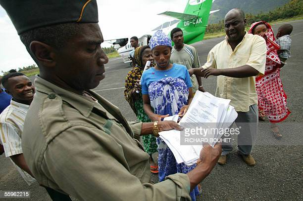 An Anjouan border officer check documents as Anjouan illegal immigrants who attempted to reach Mayotte island an overseas French Indian Ocean...