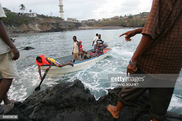 Comoran islanders from Anjouan in the Comoros archipelago leave the waterfront in a boat in Anjouan attempting to illegally enter Mayotte island an...