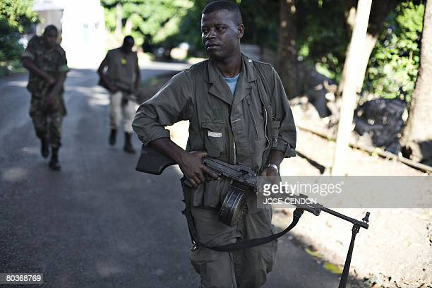 Anjouanese gendarmes take positions to fight the Comoran and African Union troops in Ouani near Mutsamudu on March 25 2008 African Union and Comoran...