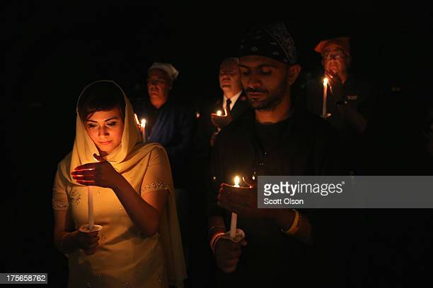 Anju Bhatia and Indi Biring join members of the Sikh Temple of Wisconsin their guests and supporters for a vigil to mark the oneyear anniversary of...