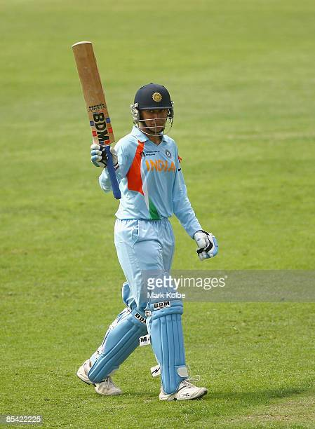 Anjum Chopra of India celebrates scoring her half century during the ICC Women's World Cup 2009 Super Six match between Australia and India at North...