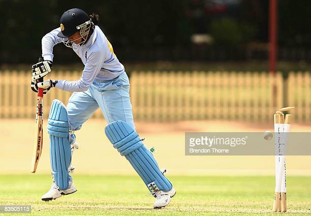Anjum Chopra of India is bowled by Ellyse Perry of Australia during the first women`s one day international match between the Australian Southern...