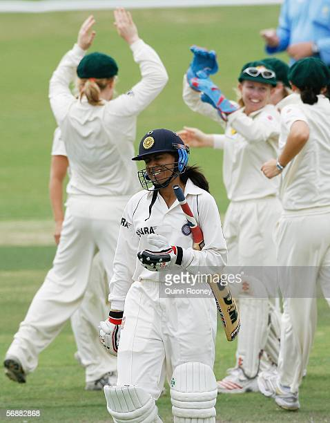 Anjum Chopra of India leaves the ground after being dismissed whilst the Australian players celebrate in the background during Day 2 of the Women's...