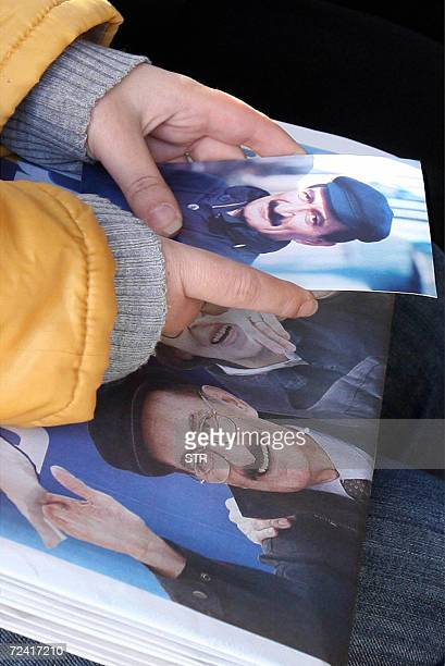 A supporter of former Turkish Prime Minister Bulent Ecevit looks 06 November 2006 at Ecevit`s pictures after he died at 81 in a hospital Turkey...