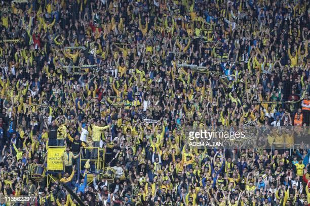 Ankaragucu's supporters cheer for their team during the Turkish Super Lig football match between Ankaragucu and Fenerbahce at Eryaman Stadium in...