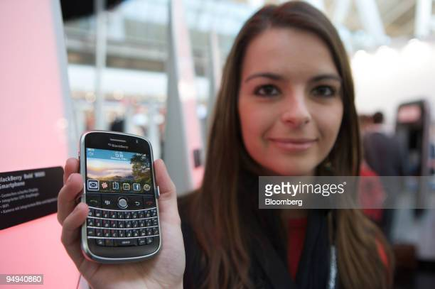 Anke Bursie holds a Blackberry Bold 9000 smartphone at CeBIT in Hannover Germany on Tuesday March 3 2009 Makers of software computers and...