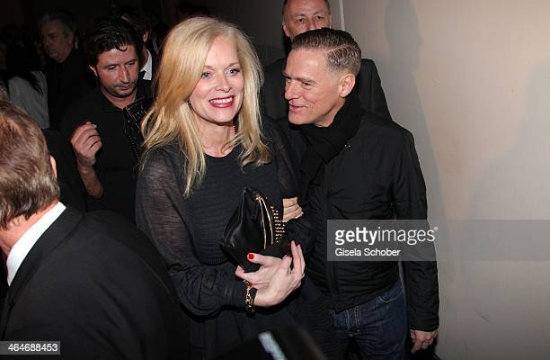 MUNICH GERMANY JANUARY Anke Degenhard Bryan Adams attend the presentation and vernissage of the calender 'THE ADAM BY BRYAN ADAMS' for Opel at Haus...