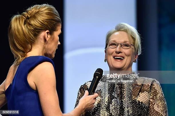 Anke Engelke and jury president Meryl Streep speak on stage during the opening ceremony of the 66th Berlinale International Film Festival Berlin at...