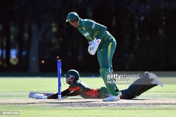 Ankit Hirani of Kenya dives to save his wicket during the ICC U19 Cricket World Cup match between South Africa and Kenya at Lincoln Green on January...